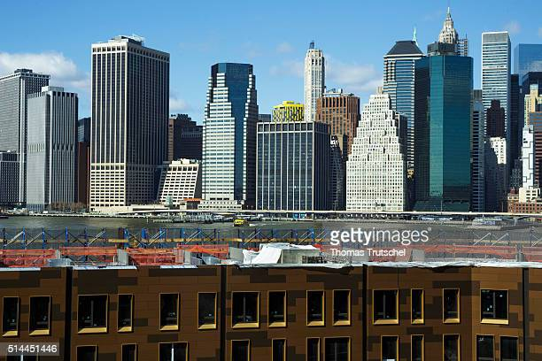 New York United States of America February 26 Construction site of residential buildings in Brooklyn in front of Manhattan skyline on February 26...