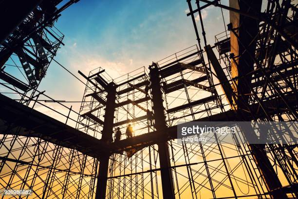 construction site on sunset background - built structure stock pictures, royalty-free photos & images