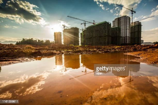 bouwplaats - bouwplaats stockfoto's en -beelden