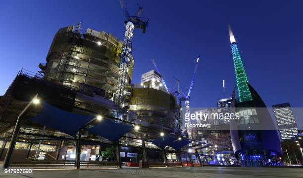 A construction site stands near the Bell Tower right in the Elizabeth Quay area of Perth Australia on Wednesday April 11 2018 Australia is scheduled...