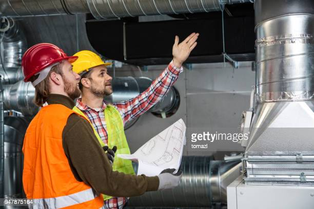 construction site teamwork - air duct stock pictures, royalty-free photos & images