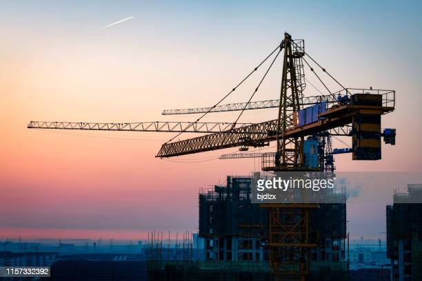 construction site under sunset - real estate stock pictures, royalty-free photos & images