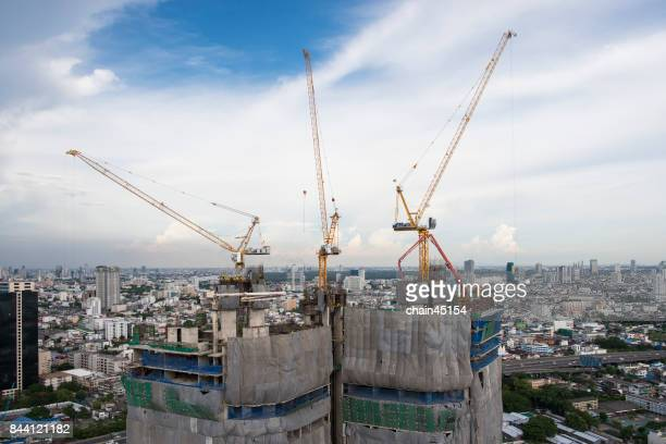 Construction site with cranes from aerial view sky background.