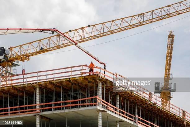 BERLIN GERMANY AUGUST A construction site with cranes on the roof of a building on August 10 2018 in Berlin Germany