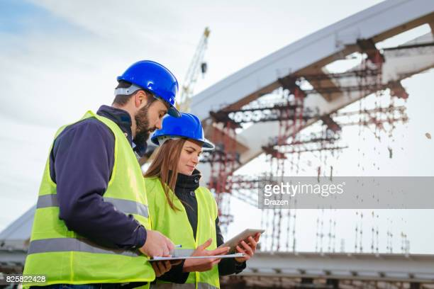 construction site with engineers and architects - bridge built structure stock pictures, royalty-free photos & images