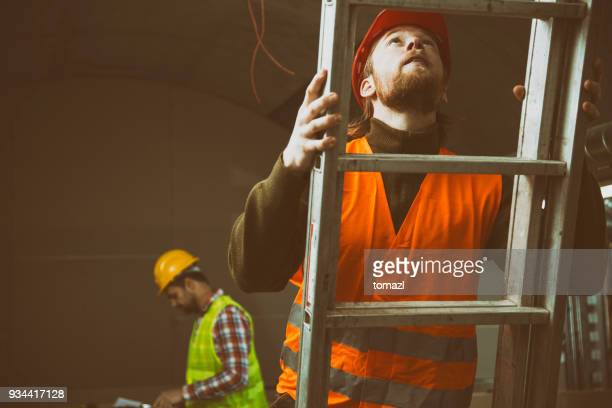 construction site with ladder - ladder stock pictures, royalty-free photos & images