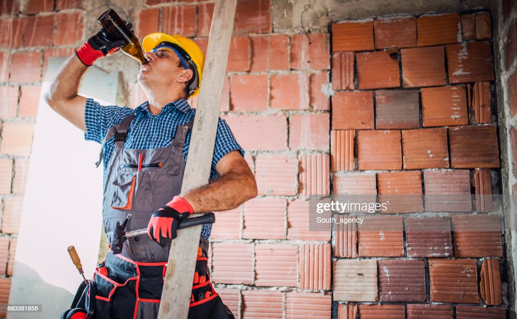 Construction site worker on break : Stock Photo
