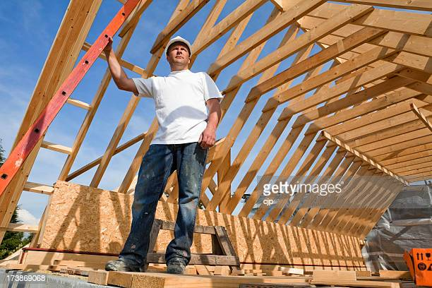 Construction Site Worker with Timber Frame Roof