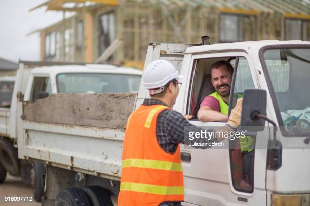 construction site workers talking before leaving building site - van stock pictures, royalty-free photos & images