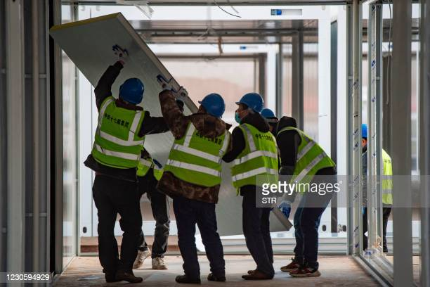 Construction staff work at the construction site of the centralized medical observation centre, a makeshift facility to isolate people at risk of...