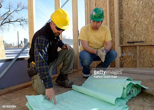 Blueprint denver stock photos and pictures getty images construction supervisor keith faris left shows future homeowner leo hermosillo the blueprints for the town home malvernweather Gallery