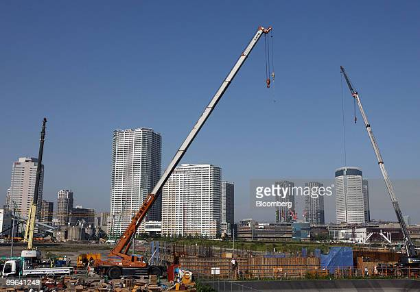 Construction takes place in front of residential buildings in the Toyosu district of Tokyo Japan on Wednesday June 23 2009 Japan will set up a fund...