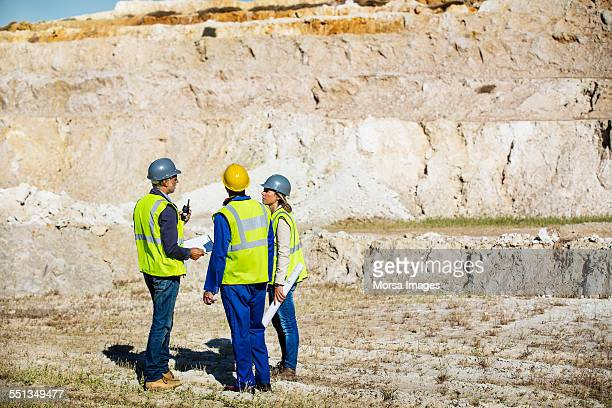 Construction team discussing at quarry