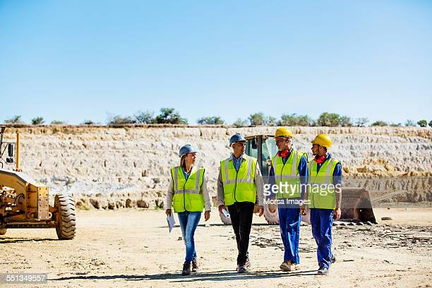 construction team discussing at quarry - four people stock pictures, royalty-free photos & images