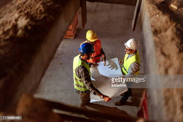 construction team discussing at site - restoring stock pictures, royalty-free photos & images