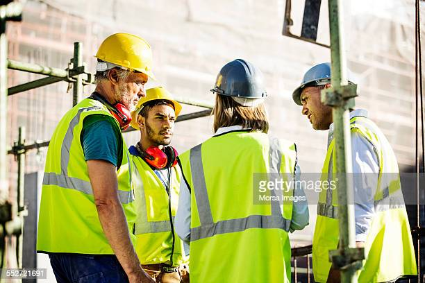 Construction team discussing at site