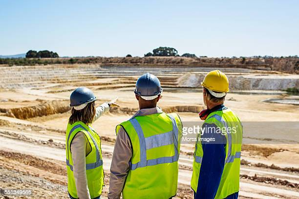 construction team examining quarry - gruva bildbanksfoton och bilder