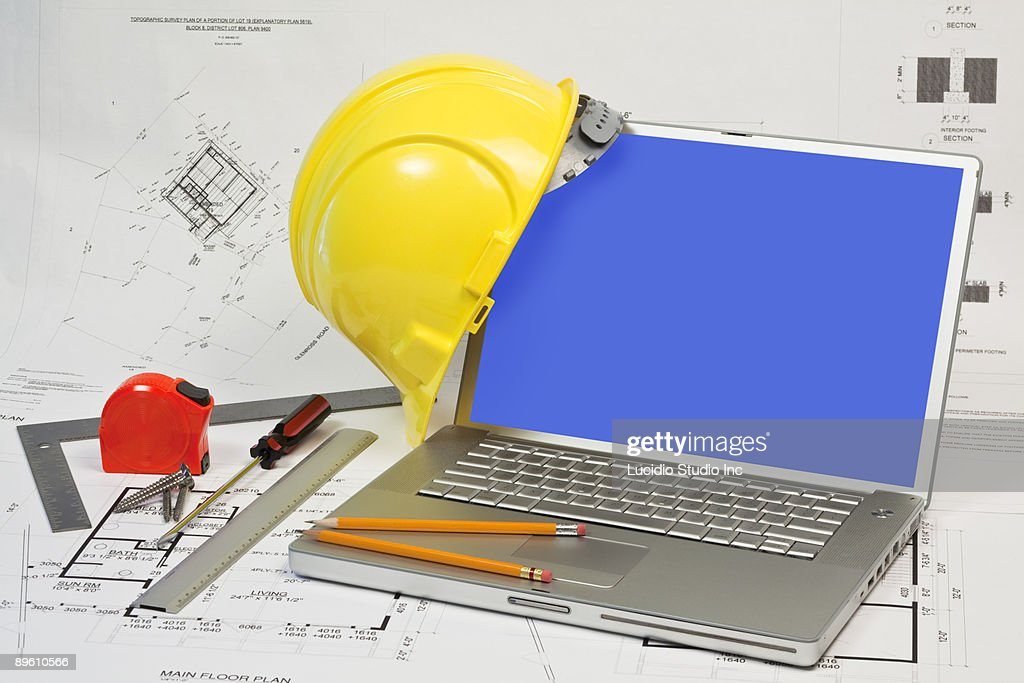 Construction tools, plans and laptop : Stock Photo