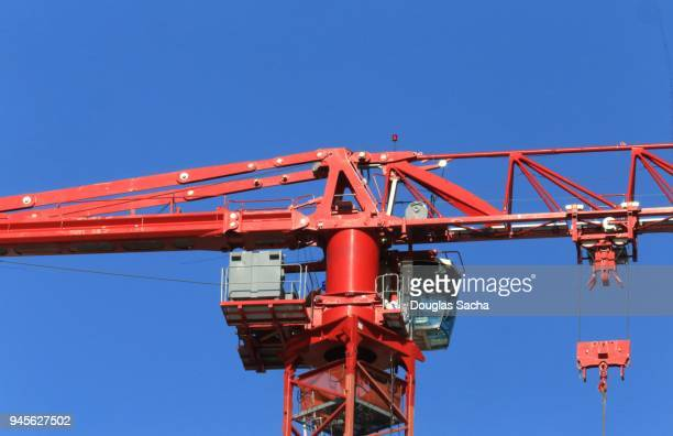 construction tower crane - sail boom stock pictures, royalty-free photos & images