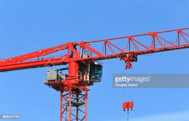 construction tower crane with operators cab along the boom and mast - sail boom stock pictures, royalty-free photos & images