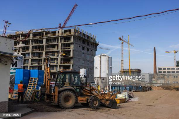 Construction vehicle and building materials beside a residential apartment block construction site, on a plot of brownfield land in the Vysoany...