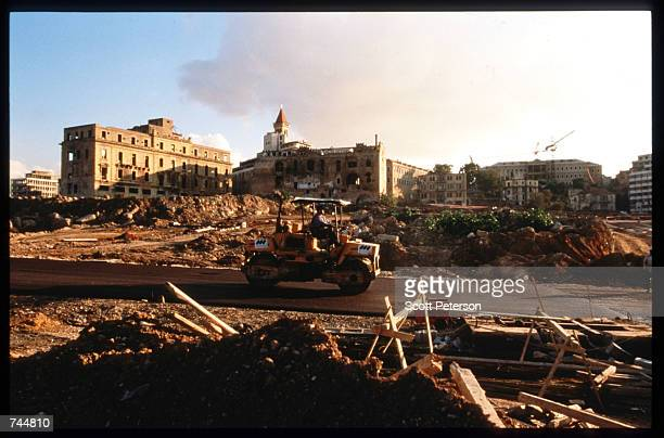 A construction vehicle drives through a construction site January 13 1997 in Beirut Lebanon The Bourse de Beyrouth was closed in 1983 during Israel's...