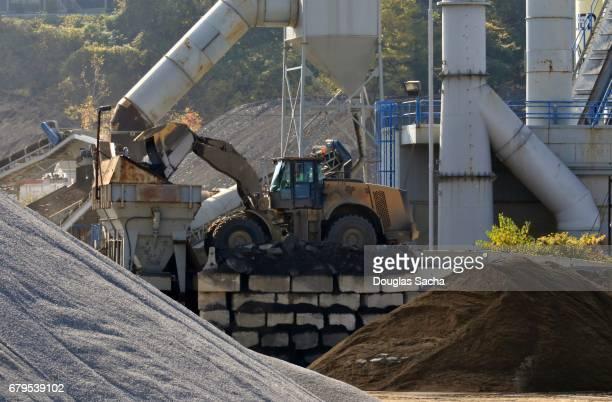 Construction vehicle loads a hopper