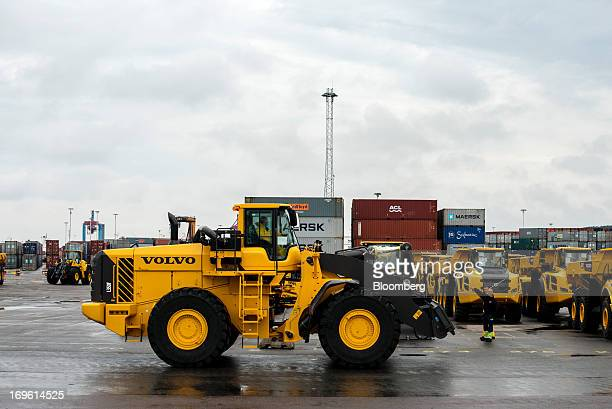 Construction vehicles manufactured by Volvo AB the Swedish truckmaker are prepared for shipping on the dockside at the Port of Gothenburg in...