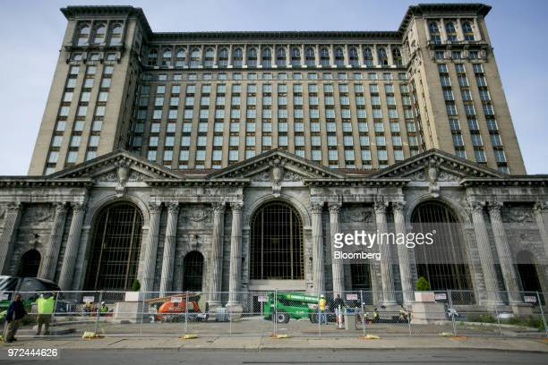 Construction vehicles sit parked outside the Michigan Central Train Station in the Corktown neighborhood of Detroit Michigan US on Monday June 12...