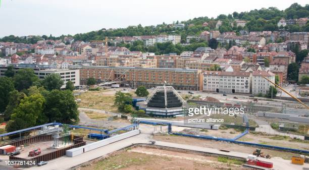 Construction vehicles stand in a construction site of the controversial railway project Stuttgart 21 in Stuttgart Germany 02 July 2014 The Deutsche...
