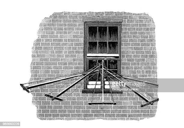 Construction with poles and ropes tumble dryer at the window industrial product from the year 1880 digital improved reproduction of a woodcut from...