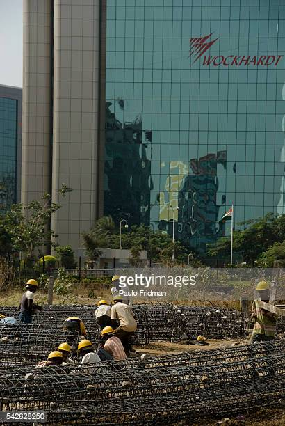 Construction with the Wockhardt Towers a pharmaceutical and biotechnology company Towers in background in Mumbai Maharastra India
