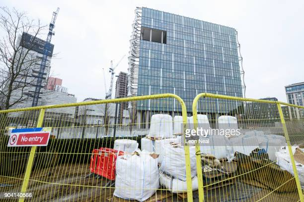 Construction work continues around the new US embassy as soldiers prepare to raise the American flag for the first time on January 12 2018 in London...