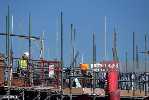 Construction work continues at a building site for new homes and houses being built at a Barrat Developments residential property development in...