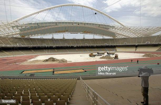 Construction work continues at the main Olympic Stadium the OAKA Olympic Sports Complex ahead of the August Olympic Games on June 17 2004 in Athens...