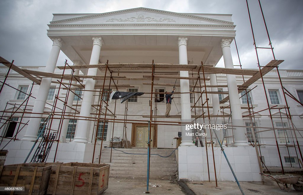Construction work continues on a replica White House, a $20million villa being built inside Dream City, a new exclusive residential suburb that is being developed in Erbil on December 15, 2014 in Erbil, Iraq. Dream City, is one of several high value residential areas that have been built in the Kurdistan capital since 2003 and are complete with their own mosque, shopping areas and schools. Property values vary, but many villas in the gated and walled development are now valued at over $1million and it even features a $20million US White House replica. Despite insecurity in the rest of Iraq, the semi autonomous region of Kurdistan has been seen by some investors as the new Dubai and although the advance of Islamic State and a budget row with Baghdad has dampened some of the enthusiasm, the city skyline is still changing at a rapid pace.