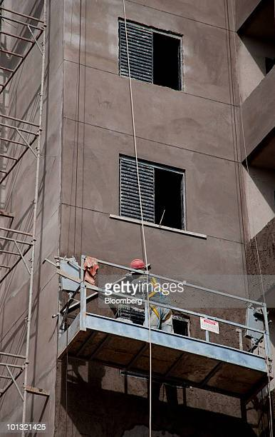 Construction work continues on a residential apartment complex in Campo Limpo Sao Paulo Brazil on Saturday May 29 2010 Shares of Gafisa SA Brazil's...