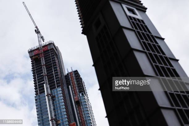 Construction work continues on a residential highrise on the Isle of Dogs in London England on July 30 2019 Research by the New London Architecture...