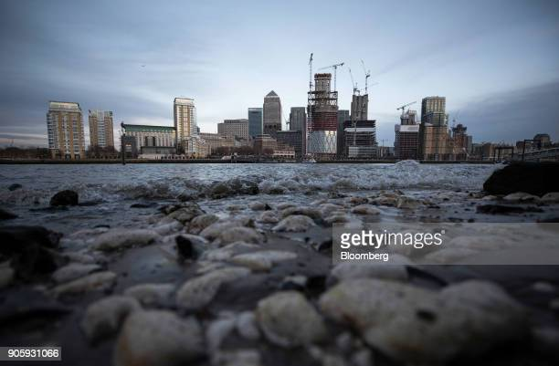 Construction work continues on skyscrapers at the Canary Wharf financial shopping and business district in London UK on Tuesday Jan 16 2018...