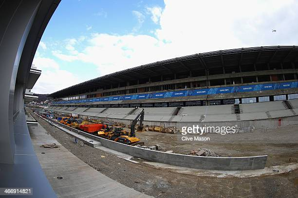 Construction work continues on the Formula One pitlane and main straight at the Sochi International Street Circuit ahead of the Sochi 2014 Winter...