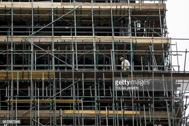 Construction work is seen continuing on the burnedout shell of Grenfell Tower in west London on May 11 2018 British Prime Minister Theresa May on May...