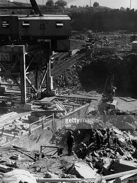Construction work on the site of a dam built by the Tennessee Valley Authority a public corporation which provides electricity to deprived areas of...