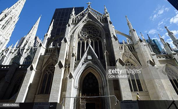 A construction worker along the south side of St Patrick's Cathedral September 23 2015 in New York New York City is preparing for the visit of Pope...