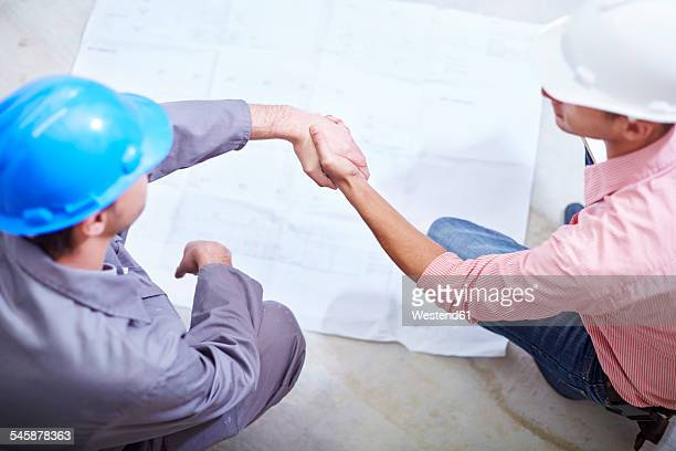 Construction worker and foreman meeting on construction site