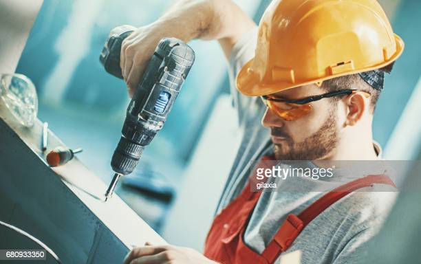 construction worker assembling a drywall. - foundation make up stock pictures, royalty-free photos & images
