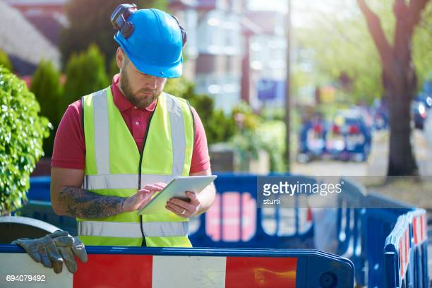 construction worker at a road dig