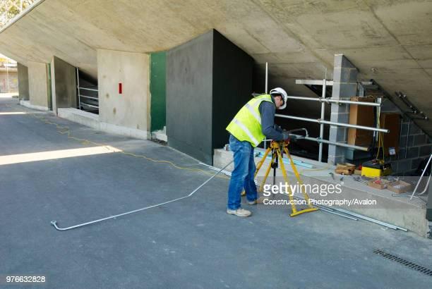Construction worker at All England Lawn Tennis Club, Wimbledon, London, UK, 2008.