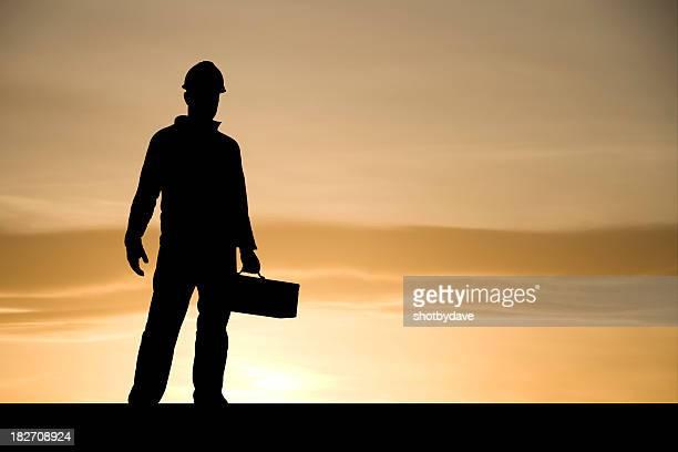 Bauarbeiter im Morgengrauen