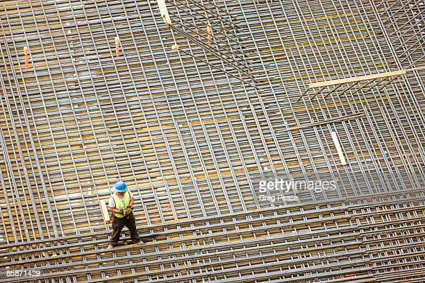 Construction Worker at High-rise Building Site