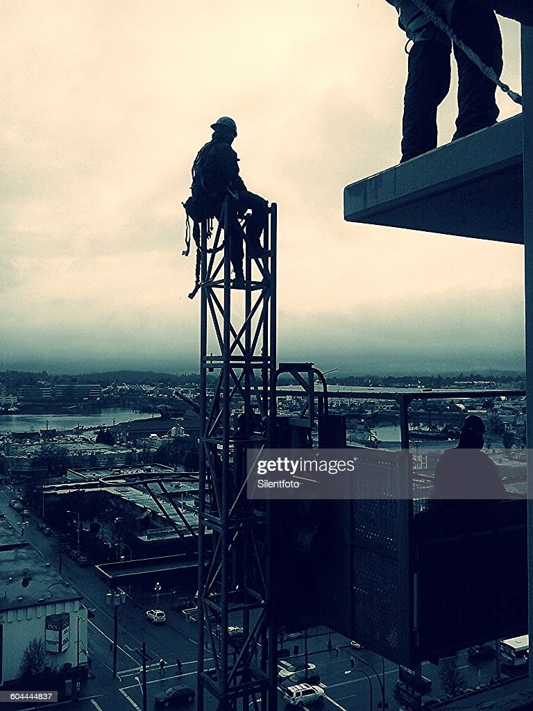 Construction Worker At Rest High Up In The Air : Stock Photo